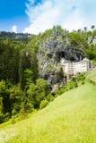 Predjama castle in Slovania. Panorama of mountain cliff and Predjama castle Royalty Free Stock Photo