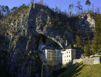 Predjama Castle Slovenia. One Of The Most Chilling Haunted Castles In The World. A castle built within a cave, now that is brilliant in terms of defense and Stock Photos