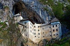 Predjama slott Arkivbild