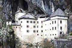 Predjama slott Arkivfoton