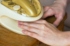 Predrying the fingers and nails in the device for manicure Royalty Free Stock Photo