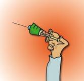 Preensão da mão uma seringa Imagem de Stock