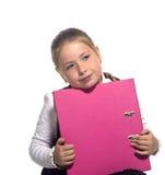Preensão triste da menina da escola um livro imagem de stock