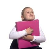 Preensão triste da menina da escola um livro fotografia de stock royalty free