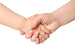 Preensões da mulher pela criança da mão imagens de stock
