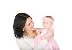 Preensões do Mum nas mãos do bebê. fotos de stock royalty free