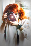 Preetty photographer is shooting Royalty Free Stock Photography