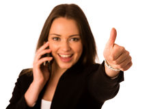 Preety asian caucasian business woman gesturing success showing stock images