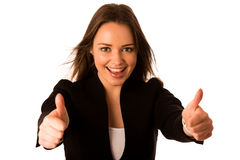 Preety asian caucasian business woman gesturing success showing Royalty Free Stock Image