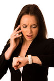 Preety asian caucasian woman looks watch gesture being late Royalty Free Stock Images