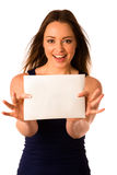 Preety assian caucasian woman holding a white card Stock Image