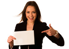 Preety assian caucasian woman holding a white card Royalty Free Stock Photography