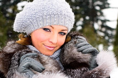 Preety girl in winter forest Stock Photo