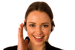 Preety happy asian caucasian business woman with headset Royalty Free Stock Image