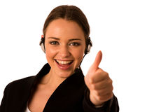 Preety happy asian caucasian business woman with headset showing Royalty Free Stock Photos
