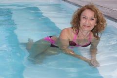 Preety middle aged woman in bikini in pool Royalty Free Stock Photography