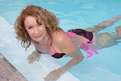 Preety middle aged woman in bikini in pool Royalty Free Stock Images