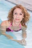 Preety middle aged woman in bikini in pool Stock Images