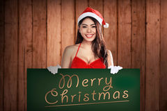 Preety Santa Woman Holding Merry Christmas Board Stock Images