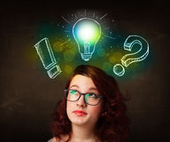 Preety teenager with hand drawn light bulb illustration Royalty Free Stock Photos