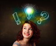 preety teenager with hand drawn light bulb illustration Stock Photo