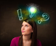 Preety teenager with hand drawn light bulb illustration Royalty Free Stock Images