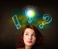 Preety teenager with hand drawn light bulb illustration Stock Photos