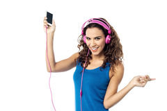 Preety woman listening to the music from smart phone Royalty Free Stock Images