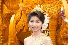 Preety woman show at thai art candle sculpture. Stock Image