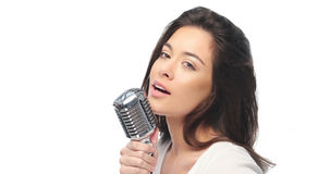 Preety woman singing into a microphone Stock Images