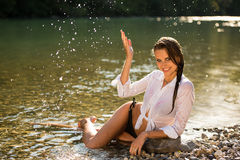Preety woman in swimsuit near alpine river in early summer Royalty Free Stock Photography
