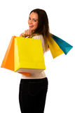 Preety young woman with colorful shopping bags isolated over whi Stock Photo