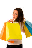 Preety young woman with colorful shopping bags isolated over whi Royalty Free Stock Photos