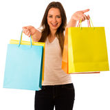 Preety young woman with colorful shopping bags isolated over whi Stock Photos