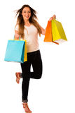 Preety young woman with colorful shopping bags Royalty Free Stock Images