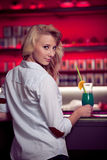 Preety young woman drinks cocktail in a night club Royalty Free Stock Photos