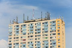 Prefab. Many antennas on the top of the roof Stock Photo