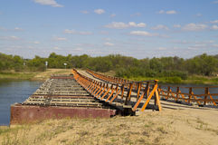 Prefabricated pontoon bridge across the river. Pictured bridge over the river, built in a short period of military engineers Stock Photography