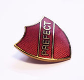 Prefect badge. Close up of a red prefect badge Stock Images