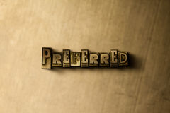 PREFERRED - close-up of grungy vintage typeset word on metal backdrop Stock Photos