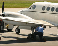 Preflight Check. Mechanic doing preflight check of plane Royalty Free Stock Photos