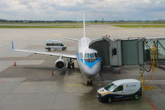 Preflight service of the plane in Warsaw Chopin Airport, Poland Stock Photography