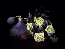 Prefume of old times. Dried flowers with vintage profume Royalty Free Stock Photography
