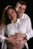 Preg couple in white Stock Photos