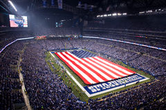Pregame at Lucas Oil Stadium. A giant American Flag is displayed during the national anthem before kickoff at Lucas Oil Stadium on November 15, 2009. The game