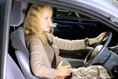 Pregancy woman drive a car Royalty Free Stock Image