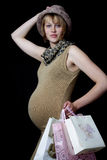 A pregant woman buying presents for a baby royalty free stock photography