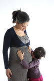 Pregant woman with her daughter Royalty Free Stock Photography