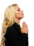 Pregare biondo della donna Fotografie Stock Libere da Diritti
