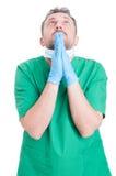 Pregare del chirurgo o di medico Fotografia Stock Libera da Diritti